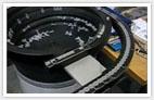 Les produits Vibratech, bol vibrant de distribution de lentilles à 2 sorties entraxe 130mm